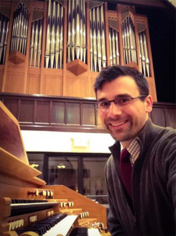 Dr. Russell Weismann sitting at the organ